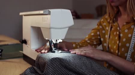 designing : Young woman using sewing machine, startup business.