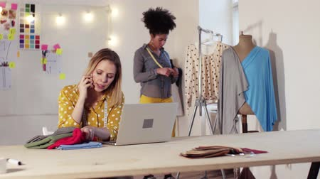 brazil : Young creative women with smartphone in studio, startup business.