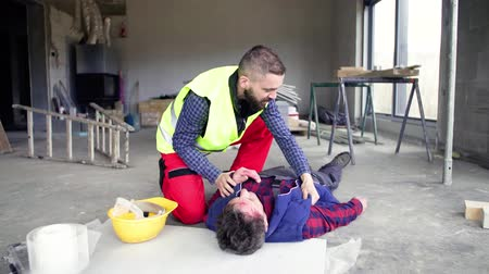vest : Accident of a man worker at the construction site.