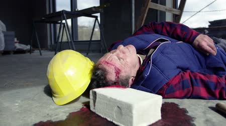health insurance : Accident of a man worker at the construction site.