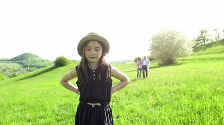 grandad : A small girl with grandparents walking outside in spring nature. Stock Footage