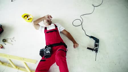 health insurance : Top view of an injured man lying on the floor after an accident at work.