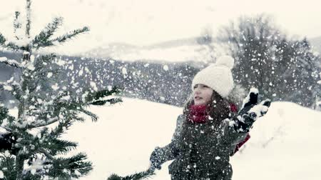 throwing in : Unrecognizable grandfather and small girl getting a Christmas tree in forest. Stock Footage