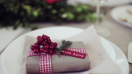 christmas tree with lights : A table set for a dinner at home at Christmas time. Stock Footage