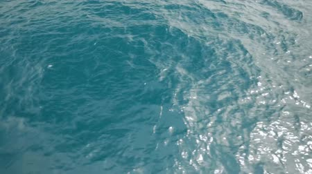Ocean water with small waves in the daytime. Stock Footage