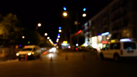 A walk in the night city in the side with passing people Stock Footage