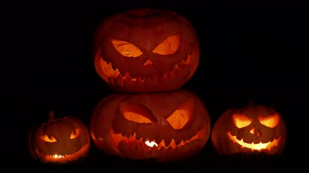 Halloween pumpkin on a black background with burning eyes Stock Footage
