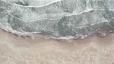 Aerial view of a beach with conde to the blue sea Stok Video