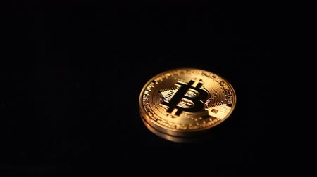 golden time : Gold bitcoin coin in focus and defocus