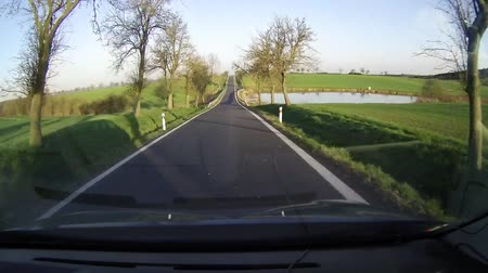 nações : Driving the country road (outside of city), captured on dashcam in the car.