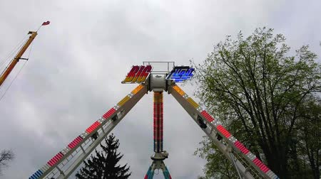 kutna : KUTNA HORA, CZECH REPUBLIC - APRIL 15, 2017: Swinging adrenaline amusement at annual traditional fair on April 15, 2017 in Kutna Hora.