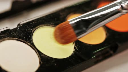 eyeshade : Makeup brush moving over multicolor eye shadows palette