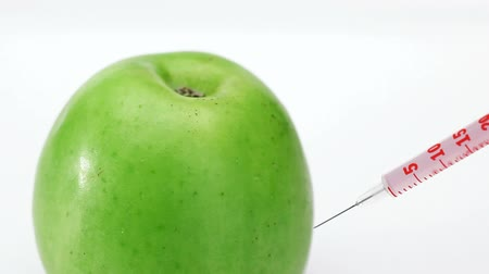 strzykawka : GMO apple injection with three syringe on the white background