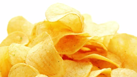 crocante : Potato chips heap rotating over white background, macro view