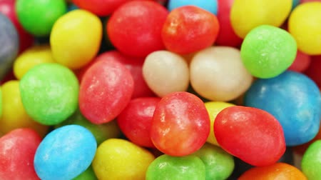 colorful candy : Multicolor bonbon sweets (ball candies) rotating food background, closeup view Stock Footage