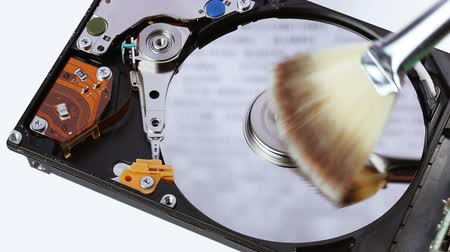 besom : Hard disk drive (hdd) cleaning with brush broom, closeup