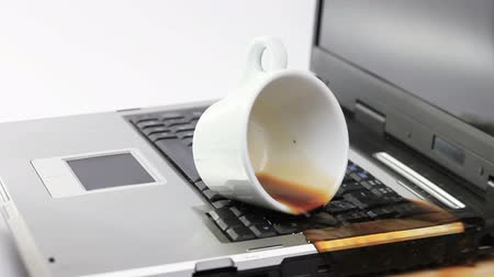 black coffee : Coffee spilled over working notebook