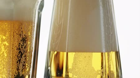 piwo : Lager beer pouring in glass, sliding video