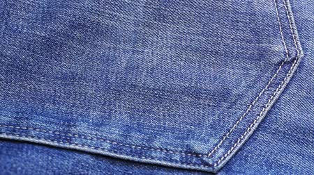 bolso : Blue jeans cloth background, sliding video