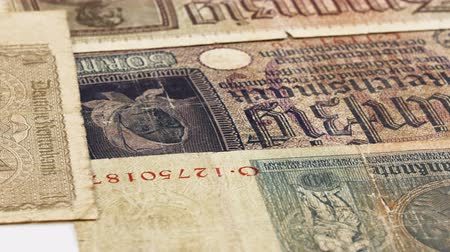threadbare : Third reich nazi banknotes 1942 WW2 in occupied Ukraine, rotating background, loop ready