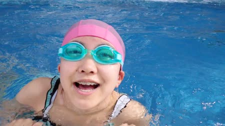 Japanese girl doing the butterfly in the swimming pool