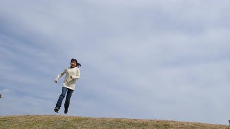gimnazjum : Japanese girl running and jumping in the blue sky