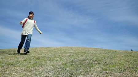 heyecan verici : Japanese elementary school girl running in the blue sky