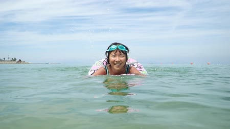 thrash : Japanese girl enjoys sea bathing Stock Footage