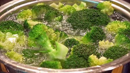 cooking pots : Broccoli in a pot with boiling water (close-up footage)