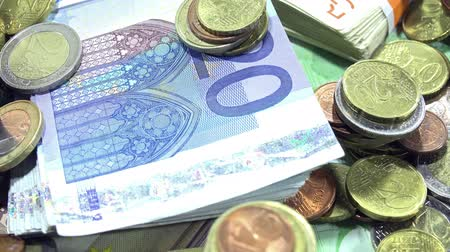 euro : Money (euro coins and banknotes) as 4K dolly shot