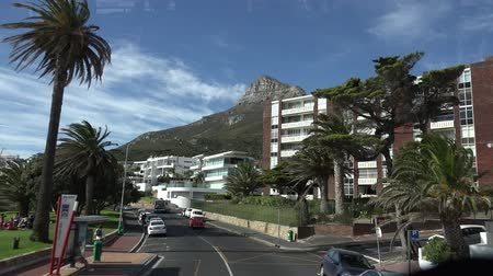 kasaba : Driving through Camps Bay Cape Town, South Africa at a sunny day 4K timelapse footage Stok Video