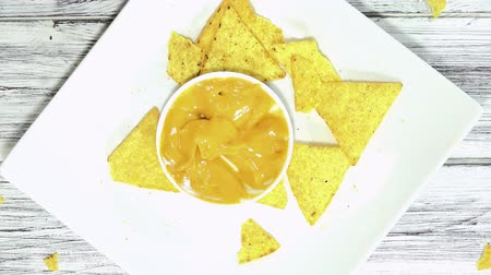 dips : Eating a portion of Nachos