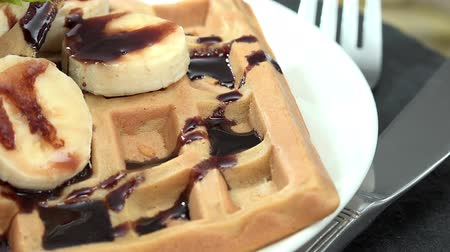 belga : Rotating Waffles with Banana slices and Chocolate sauce not loopable, 4K Stock Footage