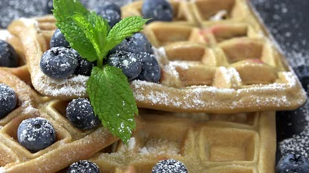 belga : Portion of fresh made Waffles with Blueberries seamless loopable, 4K Stock Footage