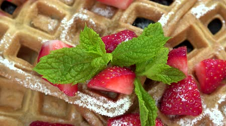 belga : Portion of homemade Waffles with fresh Strawberries seamless loopable, 4K Stock Footage