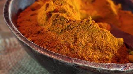 curcuma : Portion of turmeric as not seamless loopable rotating 4K UHD footage