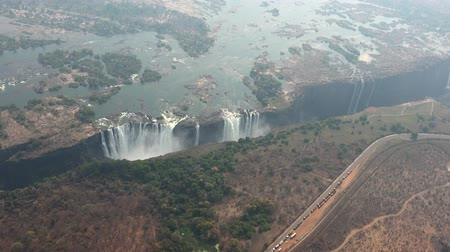 işe : Aerial view of Victoria Falls and the Zambezi River (4K UHD footage) made from a helicopter