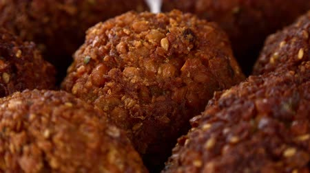 parsley : Some homemade Fried Falafel (not loopable; roating) as 4K UHD footage Stock Footage