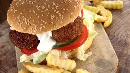 bezelye : Fresh made Falafel Burger as not loopable 4K UHD footage