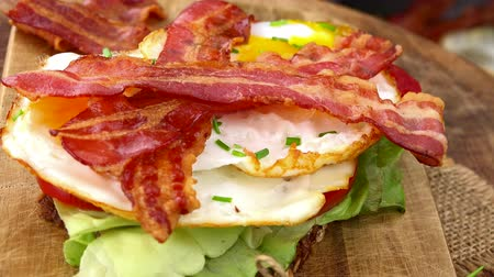 반찬 : Some homemade Fried Eggs with Bacon (not loopable; roating) as 4K UHD footage