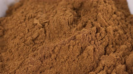 powdered : Ground Cinnamon as seamless loopable 4K footage Stock Footage