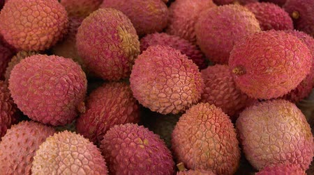 lychees : Lychees on a rotating wooden plate (seamless loopable; 4K)
