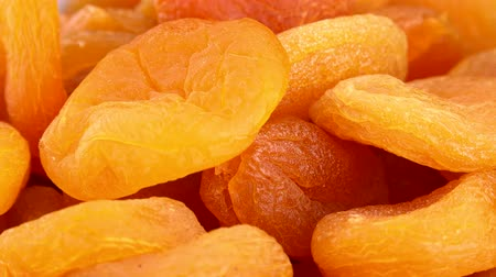 morele : Rotating Dried Apricots (seamless loopable 4K UHD footage)