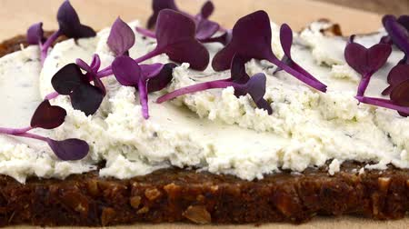 twarożek : Cream Cheese and Cress on a slice of Bread (rotating on a wooden plate; seamless loopable; 4K)