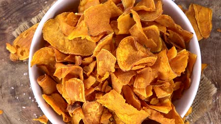 tuzlu : Fresh made Sweet Potato Chips (rotating) as seamless loopable 4K UHD footage)