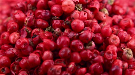 pimentas : Pink Peppercorns on a rotating wooden plate (seamless loopable; 4K)