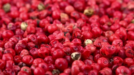 pimenta em grão : Pink Peppercorns as seamless loopable 4K footage Stock Footage