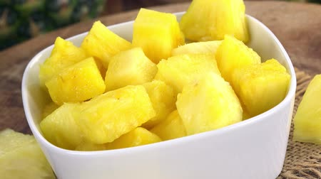 ensalada de frutas : Fresh made Sliced Pineapple (rotating) as seamless loopable 4K UHD footage)