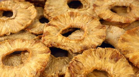 konzervált : Fresh made Dried Pineapple rings as not loopable 4K UHD footage Stock mozgókép