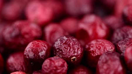 arandanos rojos : Heap of dried cranberries in not seamless loopable 4K footage